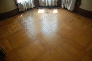 Parquet floor in the front parlor.