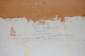 A note left on the wall by the wallpaper hangers in 1896.